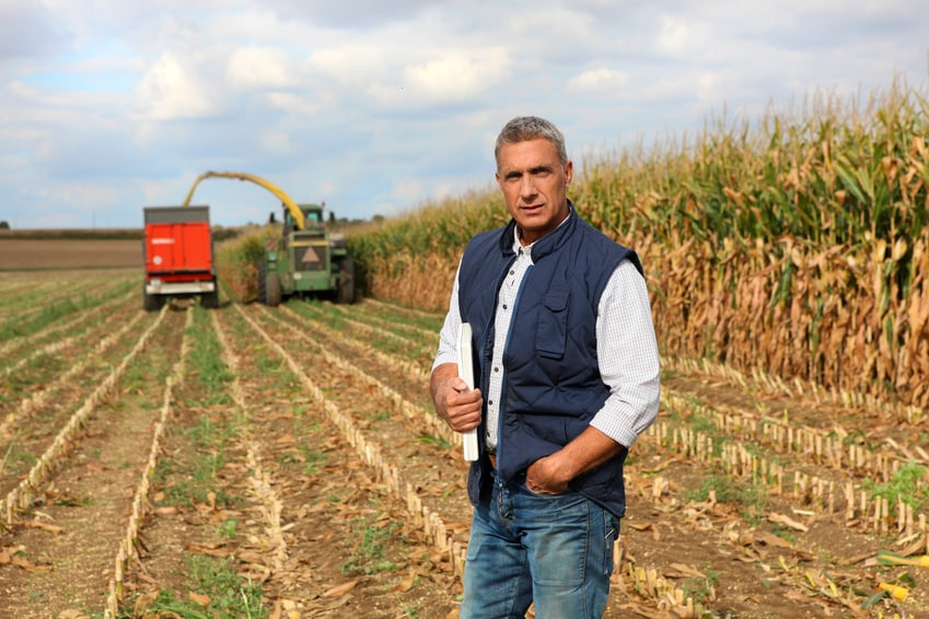 Farmer posing in his field
